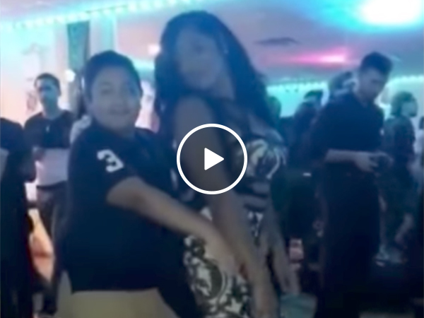 Kid Dancing With Grown Woman