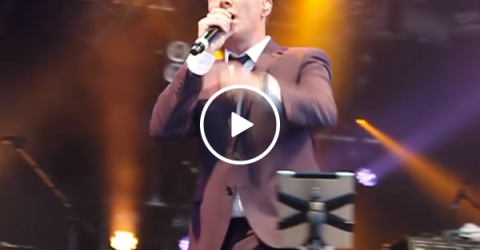 Rick Astley stops concert mid performance to break up a fight (Video)