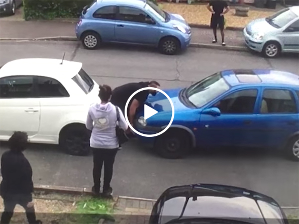 Strongman moves car in the middle of traffic dispute