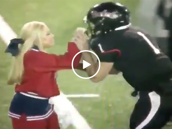 Cheerleader and Football Player Get Into a Fight