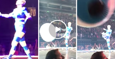 Katy Perry kicks ball into camera at her concert while singing Roar