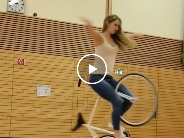 Hot Girl Does Acrobatic Tricks On a Bicycle