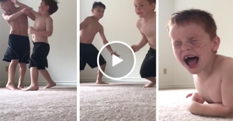 Two young brothers have a fight in slow motion