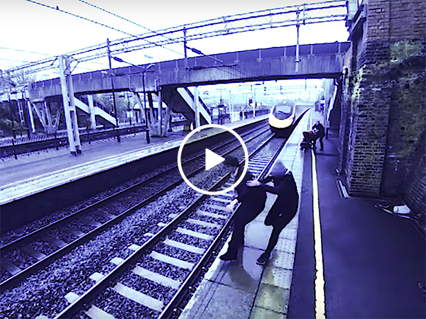 Woman saves man from jumping in front of a train