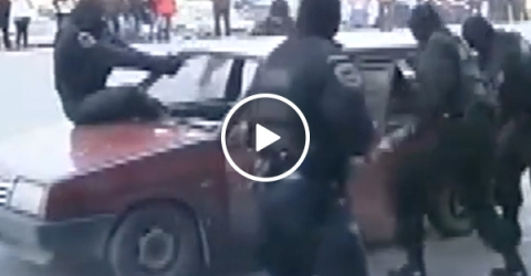 Russian police jumps into windshield to stop car (Video)