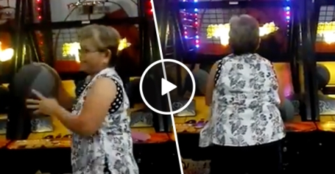 Granny demolishes basketball arcade game (Video)