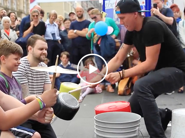 Street performer puts on amazing drum solo using buckets (Video)