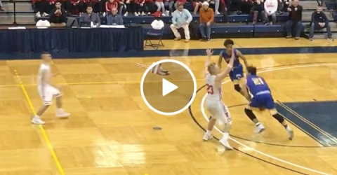 High School Basketball Player Makes A Full Court Shot To Win A Game