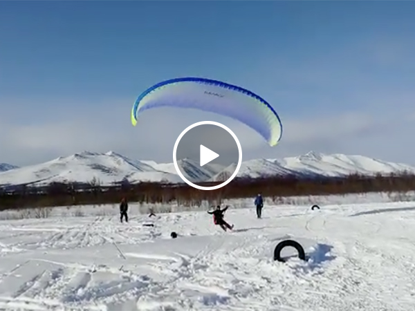 Parasailing Off a Snowmobile Goes Horribly Wrong