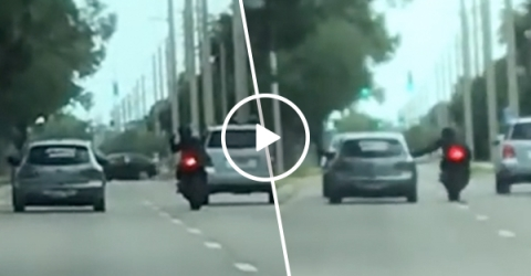Driver Crashes into Taunting Motorcycle During Road Rage (Video)