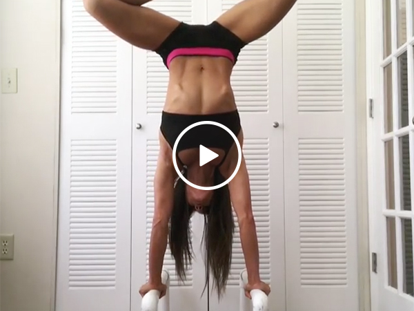 Hot girl in a Sports Bra Performs An Upside Down Handstand