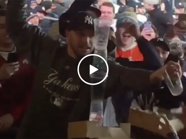 Guy Got Too Drunk At Yankees Game And Gets Cups Stacked On Him