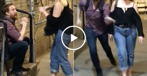 Couple's venomous fight turns on the guy filming it (Video)