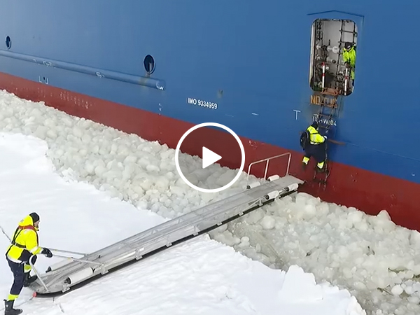 Pilot steps onto moving ship sailing through thick ice water (Video)