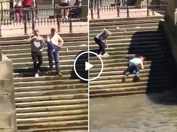 Guy Slips On Stairs And Falls All the Way Into The Water