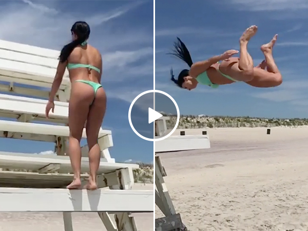 Girl In a Bikini Does a Backflip Off a Lifeguard Stand