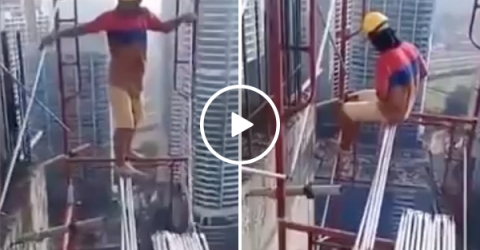 Construction worker building sky scraper without safety gear