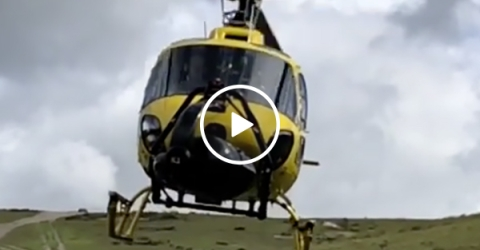 Helicopter Stuntman Films Right Under A Moving Aircraft