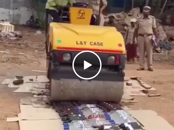 Steamroller crushes Bottles of Grey Goose and Vodka and Whiskey