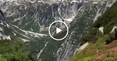 A roller coaster Perched in the Swiss Alps with a Mountainous View