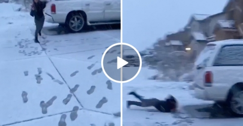 Sister takes a very painful face-plant after losing a snowball fight (Video)
